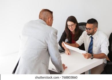 Cheerful financiers examining business documents