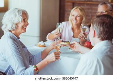 Cheerful friendly family enjoying celebration