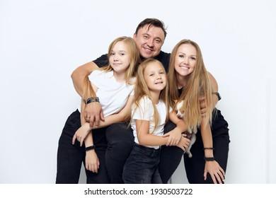 cheerful friendly family hug studio isolated background