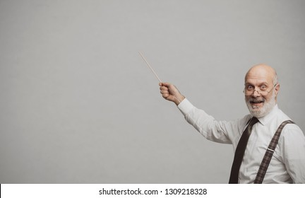 Cheerful funny academic professor smiling and pointing with a stick