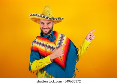 Cheerful and funny man with a Mexican sambrero on a yellow background
