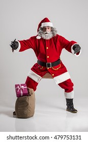 cheerful funny traditional santa claus with bag