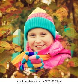 Cheerful girl in the autumn park.