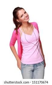 Cheerful girl in bright clothes and headphones listening to music and having fun