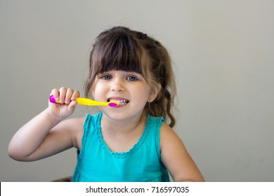 cheerful girl is brushing her teeth on nature,outdoor