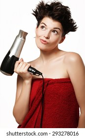 cheerful girl in burgundy towel and a hairdryer in the hands of