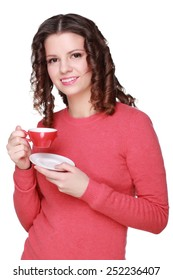 Cheerful girl in casual clothing coffee drinks on white background