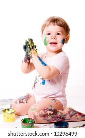 Cheerful girl clapping with hands in paint