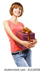 Cheerful girl with a gift box on white background