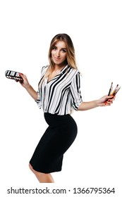 cheerful girl makeup artist in shirt and black skirt on a white background holding small eye shadow brushes and a palette