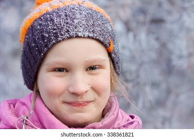 Cheerful girl in the park in winter
