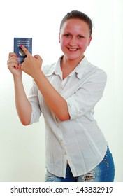 cheerful girl with a passport
