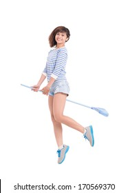 Cheerful girl riding a broom