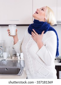 Cheerful girl standing near sink with gargle solution