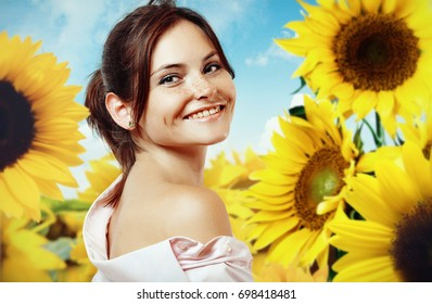 Cheerful girl in sunflowers