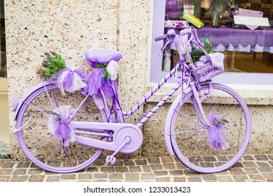 a cheerful and girly lilac bycicle at the street side