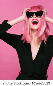 Cheerful glamorous woman pink hair glasses studio charm party