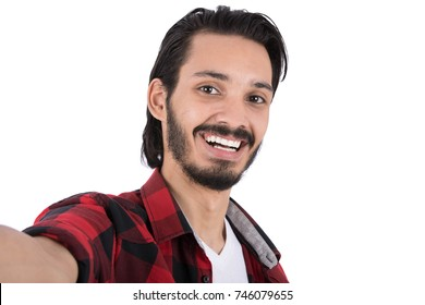 Cheerful good looking man taking selfie. Isolated on white background.