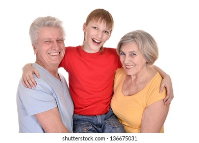 cheerful grandparents and grandson on a white background