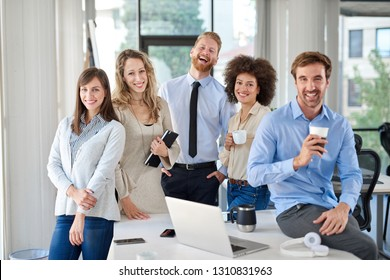 Cheerful group of business people posing in office. Multicultural group. Start up business concept.