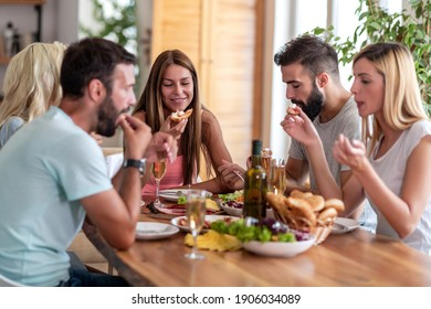 Cheerful group of friends have lunch together. Friendship,fun and leisure time concept.