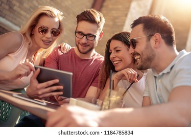 Cheerful group of friends having fun in cafe,taking selfie.