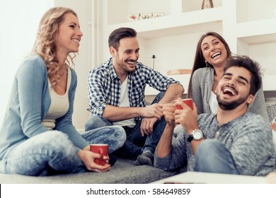 Cheerful group of friends having fun at home.