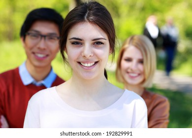 Cheerful group of students in park