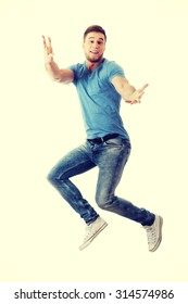 Cheerful handsome man jumping for joy.