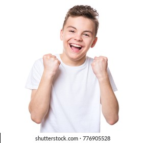 Cheerful handsome teen boy with raising hands. Emotional portrait of caucasian happy cute smiling male child, isolated on white background. Lucky child in white t-shirt celebrating triumph.