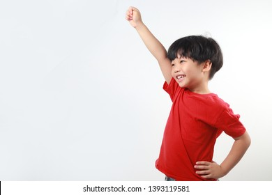 Cheerful and happy asian boy raised his hand up isolated on light background.