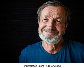 Cheerful happy bearded elderly man close-up portrait