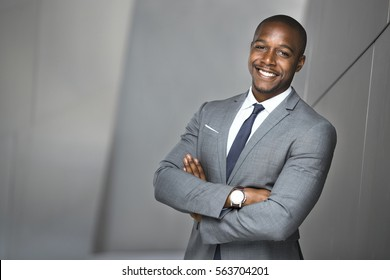 Cheerful happy big smile from attractive businessman in suit diverse ethnicity