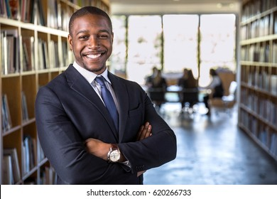 Cheerful happy confident african american business man attorney legal representative with arms crossed