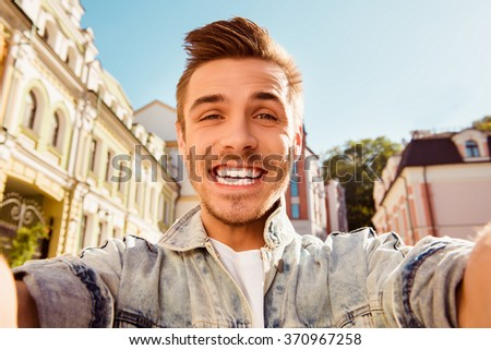 Cheerful happy man making