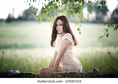 cheerful and happy woman outdoors in a field in summer