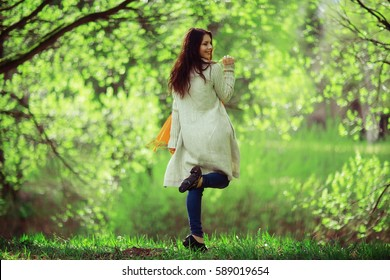 cheerful and happy young girl in the spring forest