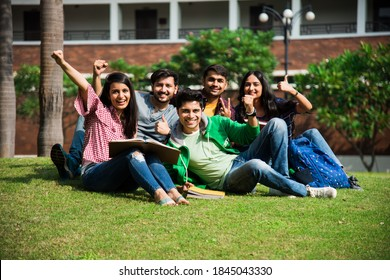 Cheerful Indian asian young group of college students or friends laughing together while sitting, standing or walking in campus