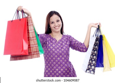 Cheerful Indian woman with shopping bags