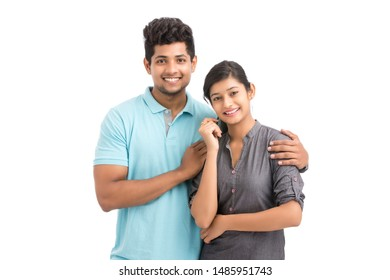 Cheerful Indian young couple on white