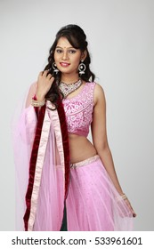 Cheerful indian young girl posing in traditional Indian dress