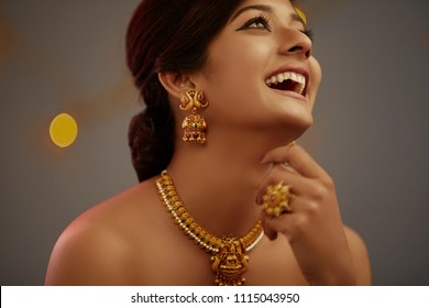 Cheerful Indian Young women beauty portrait with jewelry shot.