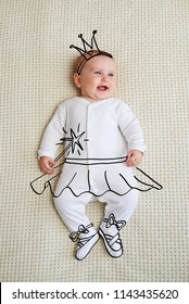 Cheerful infant baby girl sketched as fairy