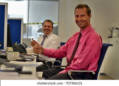 cheerful insurance agents - group of cheerful business men looking as enjoying their job