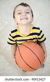 Cheerful kid with basket ball