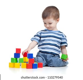 cheerful kid boy with construction set over white background