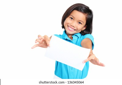 Cheerful kid showing a blank white paper. Isolated in white background.