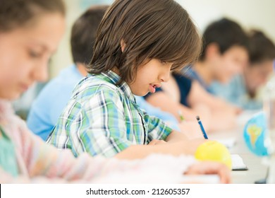 Cheerful kids learning in school classroom