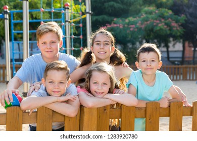 Cheerful kids posing  at the playground together