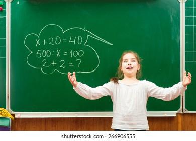 Cheerful kids at school  having education activity on chalkboard